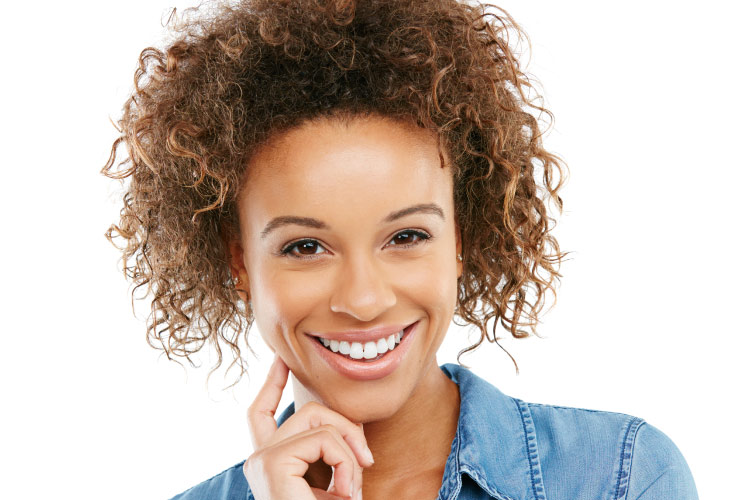 Young pretty light chocolate skinned smiling woman with curly hair piled up on her head
