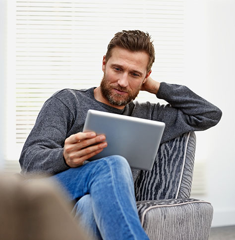 a man reading a tablet device